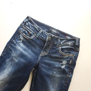Silver Jeans suki mid rise slim boot distressed